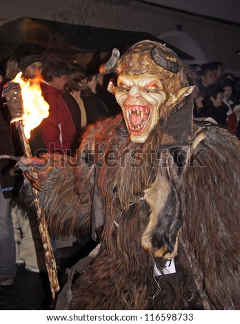 ZELL AM SEE, AUSTRIA - DECEMBER 5: Unidentified man wears Krampus (devil) mask at traditional procession on December 5, 2006 in Zell am See. - stock photo