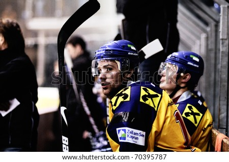 ZELL AM SEE, AUSTRIA - FEB 1: Austrian National League. Lainer and Wurzer on Zell am See bench. Game EK Zell am See vs. ATSE Graz (Result 4-1) on February 1, 2011, at hockey rink of Zell am See - stock photo