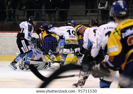 ZELL AM SEE; AUSTRIA - OCT 01: Austrian National League. A player of EKZ (blue jersey) gets crosschecked from behind. Game EK Zell am See vs Linz II (Result 5-2) on October 01, 2011 in Zell am See. - stock photo