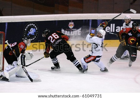 ZELL AM SEE, AUSTRIA - SEPTEMBER 3: Red Bulls Salute Tournament. Action in front of Bern Goalie Olivier Gigon. Game Jokerit Helsinki vs. SC Bern (Result 0-2) on September 3, 2010 in Zell am See - stock photo