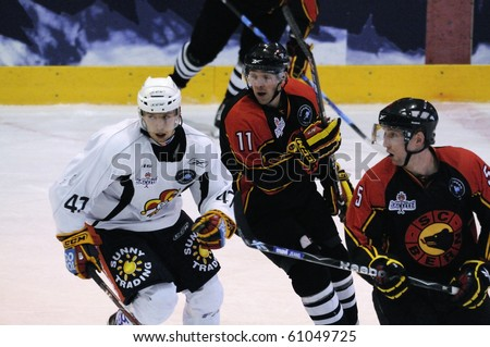 ZELL AM SEE, AUSTRIA - SEPTEMBER 3: Red Bulls Salute Tournament. Jean-Pierre Vigier (11) and Janne Lahti (47). Game Jokerit Helsinki vs. SC Bern (Result 0-2) on September 3, 2010 in Zell am See - stock photo