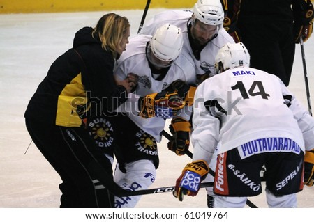 ZELL AM SEE, AUSTRIA - SEPTEMBER 3: Red Bulls Salute Tournament. Petteri Nokelainen injured after hard hit. Game Jokerit Helsinki vs. SC Bern (Result 0-2) on September 3, 2010 in Zell am See - stock photo