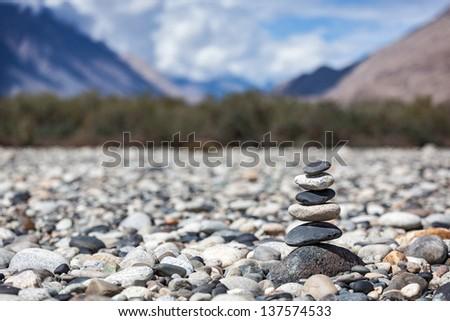 Zen balanced stones stack in Himalayas mountains - stock photo