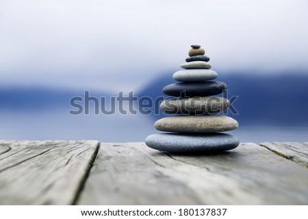 Zen Balancing Rocks o a Deck, New Zealand - stock photo