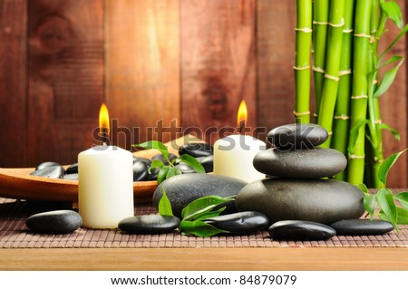 zen basalt stones and bamboo on the wood - stock photo