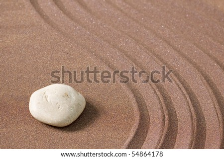 zen garden of sand and stones with copy-space - stock photo