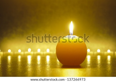 zen garden with line of candle lights - stock photo