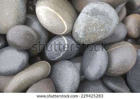 Zen-like design concept- abstract background with round pebble stones  - stock photo
