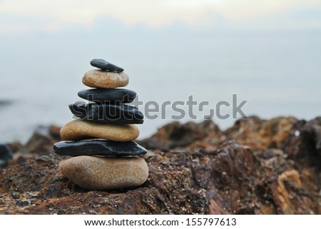 Zen meditation background - balanced stones stack on brown rock  - stock photo