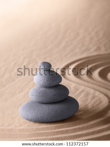 zen meditation garden japanese Buddhism concentration and relaxation stone and sand conceptual purity harmony and simplicity - stock photo
