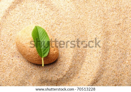 zen or spa concept with stone leaf and sand - stock photo