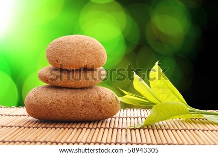 zen or spa concept with stones leaf and copyspace - stock photo