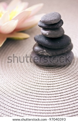 zen pile of stone and lotus flower, balance and meditation concepts - stock photo