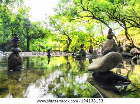 Zen pond in forest. Photography of stone towers, peace and calm concept  - stock photo