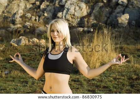 Zen pretty woman practicing exercise tai chi, kung fu or yoga in natural park - stock photo