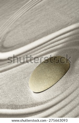 zen rock garden japanese garden zen stone tranquility and balance ripples sand pattern spa wellness relaxation - stock photo