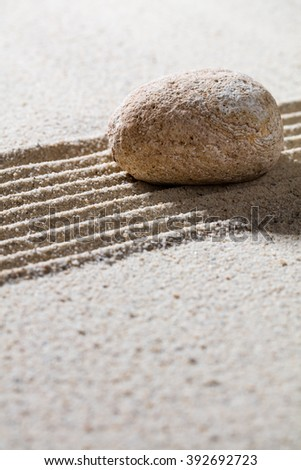 zen sand still-life - textured pebble on straight lines for concept of relaxation or tranquility, closeup  - stock photo