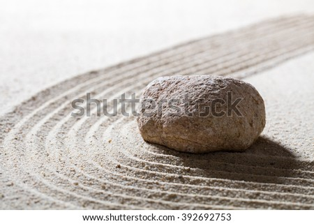 zen sand still-life - textured stone on sinuous waves for concept of serenity or beauty spa with inner peace, closeup - stock photo