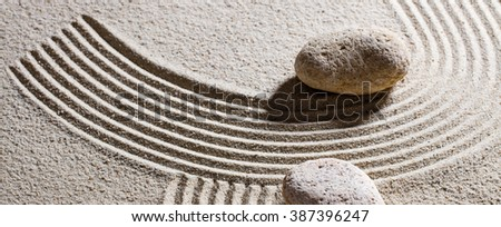 zen sand still-life - two pebbles for concept of dead end or imagination with peace and elevation - stock photo