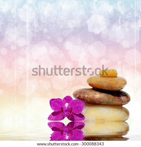 Zen spa concept background-Zen massage stones reflected in water - stock photo