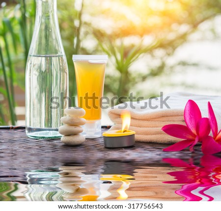zen Spa treatment with water Reflections on nature a background - stock photo
