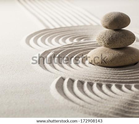 zen stillness and wellness with sand and stones garden - stock photo