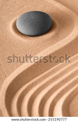 zen stone background rock and sand lines pattern for harmony serenity and relaxation in spa wellness meditation buddhism and yoga - stock photo