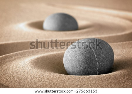zen stone garden stones and lines in sand for relaxation and meditation pure nature spirituality - stock photo