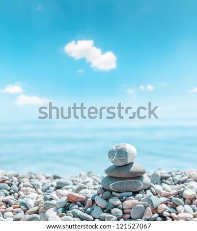 zen stone stack near sea. soft focus - stock photo