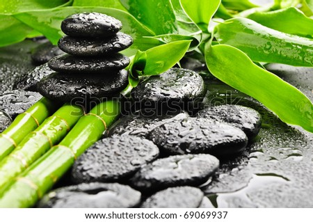 zen stones and green bamboo in the water - stock photo