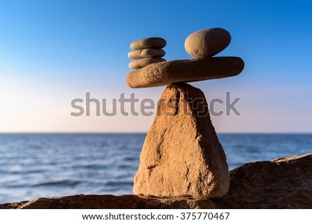 Zen stones in balance at seashore - stock photo