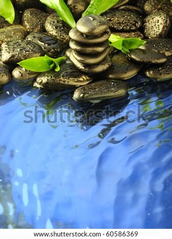zen stones in the water - stock photo