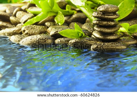 zen stones in the water - stock photo
