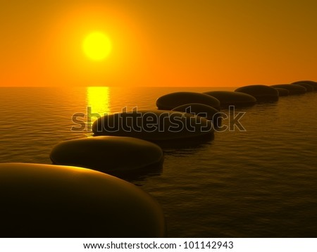 Zen stones in water and sunset - stock photo