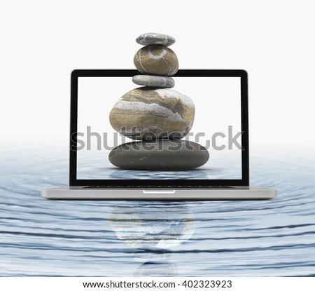 Zen stones in water getting out the laptop, Zen computing concept-  clipping path included - stock photo