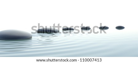 Zen stones in water on widescreen with white background - stock photo