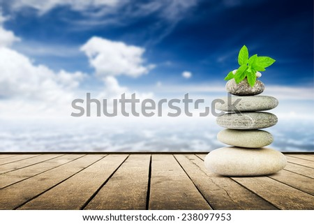 zen stones on the old wooden planks over seascape background - stock photo