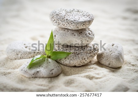 zen stones on the sand background - stock photo