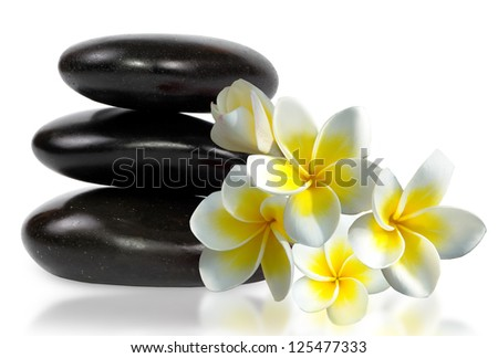 zen stones with frangipani flower - stock photo