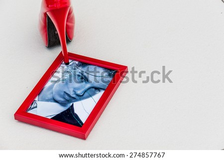 zerbrochner picture frames and high heels. symbolic photo for divorce, separation and relationship crisis - stock photo