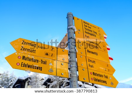 Zermatt signpost with directions to all ski runs, lifts and trails. - stock photo