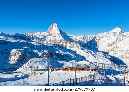 Zermatt, Switzerland - December 31, 2014 -The train of Gonergratbahn running to the Gornergrat station in the famous touristic place with clear view to  Matterhorn, starting point of the ski slope. - stock photo