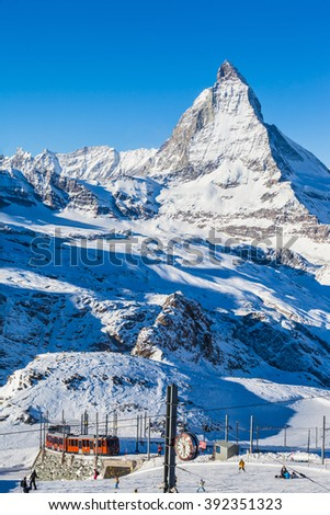 Zermatt, Switzerland - December 31, 2014 -The train of Gonergratbahn running to the Gornergrat station in the famous touristic place with clear view to  Matterhorn. It is a start of ski slope. - stock photo