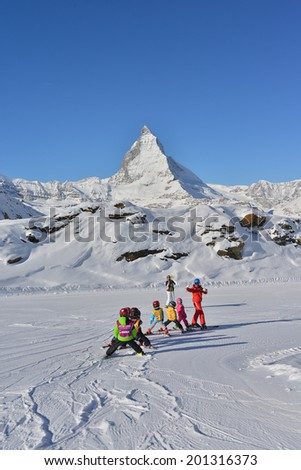 ZERMATT, SWITZERLAND - FEB 20, 2014 : Kids are training ski on Feb 20, 2014 in Rotenboden station, Zermatt, Switzerland. - stock photo