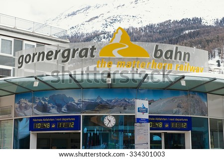 ZERMATT, SWITZERLAND - MARCH 04, 2009: Exterior of the Gornergratbahn train station sign in Zermatt, Switzerland. Zermatt is one of the most popular ski resorts in Switzerland. - stock photo