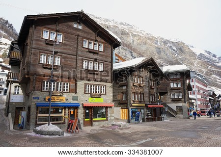 ZERMATT, SWITZERLAND - MARCH 04, 2009: Exterior of the traditional wooden buildings in Zermatt, Switzerland. Zermatt is one of the most popular ski resorts in Switzerland. - stock photo