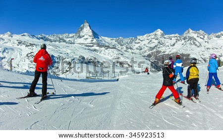 Zermatt, Switzerland - March 22, 2011: View of Matterhorn with some skiers preparing to ski from Gornergrat, Zermatt, Switzerland on March 22, 2011. - stock photo