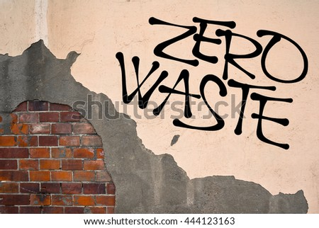 Zero waste - Handwritten graffiti sprayed on the wall, anarchist aesthetics. Appeal for ecological behavior - reuse, recycle and recover garbage and trash. Sustainable consumption - stock photo
