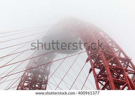 Zhivopisny cable-stayed bridge in  fog of the River Moskva  - stock photo