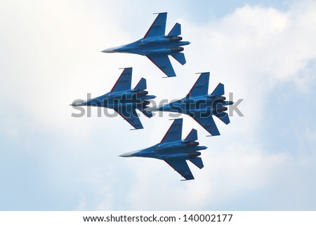ZHUKOVSKY - AUGUST 12: Aerobatic group Strizhi from Russia at airshow on 100th anniversary of Russian Air Force on August 12, 2012 in Zhukovsky, Moscow region, Russia. - stock photo